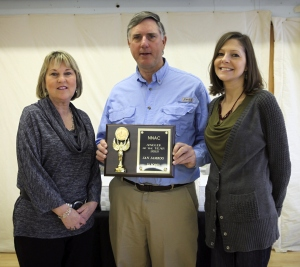 "Jan Jamrog receiving the 2012 ""NNAC Angler of the Year"" award from The Chesapeake Angler publishers Karen Jett and Laura Brady Kelley"