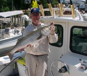 Jan Jamrog aboard his boat BAY VIEW with a 2014 rockfish.